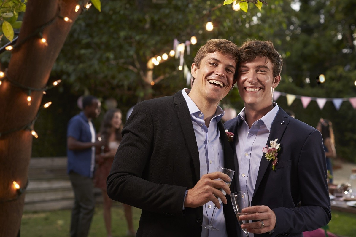 gay-couple-celebrating-wedding-with-party-in-PF6WEG_20190925-123613_1